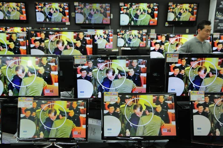 TV monitors in Seoul show the downfall of Jang Song Thaek.