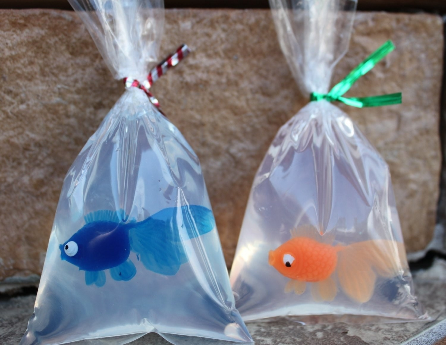 Two of the goldfish soaps in blue and orange