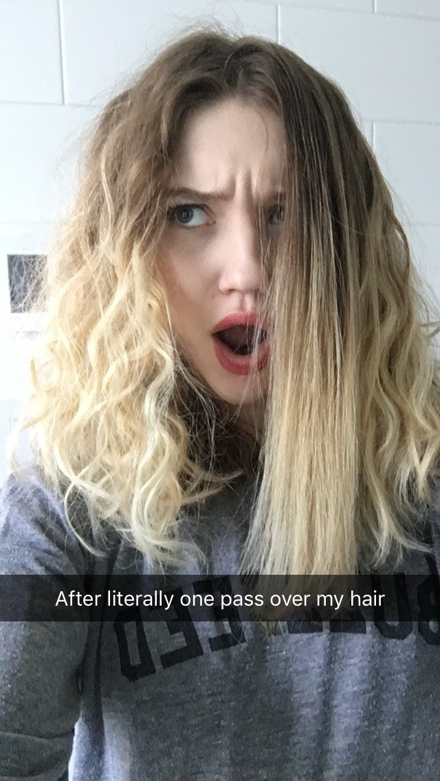 """Me with mostly wavy-curly hair and one section of completely straight hair with text """"after literally one pass over my hair"""""""