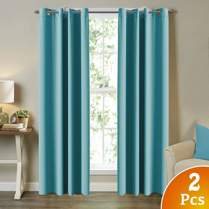 """Promising review: """"I love these curtains! I moved to Florida and found out why it was called 'the sunshine state.' I was in desperate need of the blackout curtains so I can sleep in on the weekends and keep the heat out during the day. However, I didn't want to buy two layers (blackout curtain and prettier curtain to put over it). When I found this during Amazon Prime day, it was meant to be. It darkens my room significantly. I can't really even tell if there is any sunlight outside. Also, I keep the curtains closed during the day and it seems to be keeping the room slightly cooler, which is an added bonus!"""" —TinaYKGet them from Amazon $34.99+ (available in five sizes and 17 colors)."""