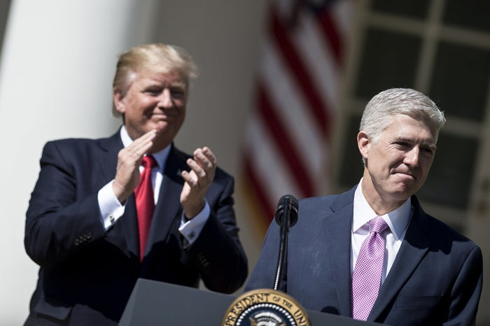 President Donald Trump applauds Justice Neil Gorsuch at his swearing-in ceremony in April 2017.