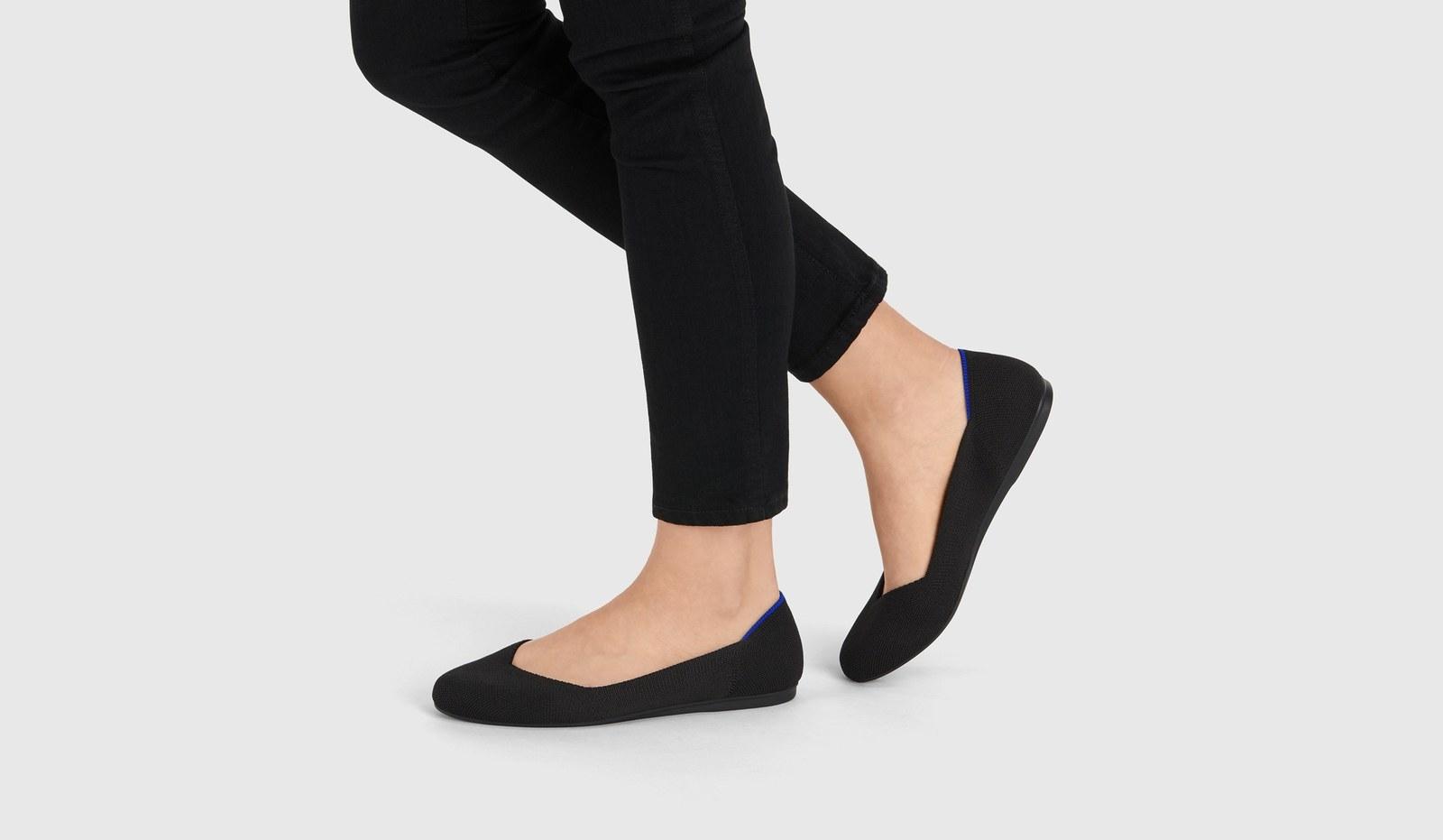 model wearing the flats in black