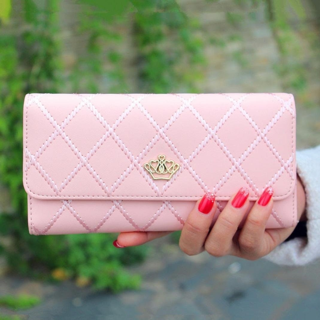 "Promising review: ""This wallet is so beautiful! It's a perfect size, the details are gorgeous, and it truly has the look of a high-end wallet. I got the light pink one, and I get compliment after compliment on this wallet even while in the high-end stores. Nicely made. I've had this for four months, and it is holding up perfectly! :-)"" —A RGet it from Amazon for $8.85+ (available in six colors)."