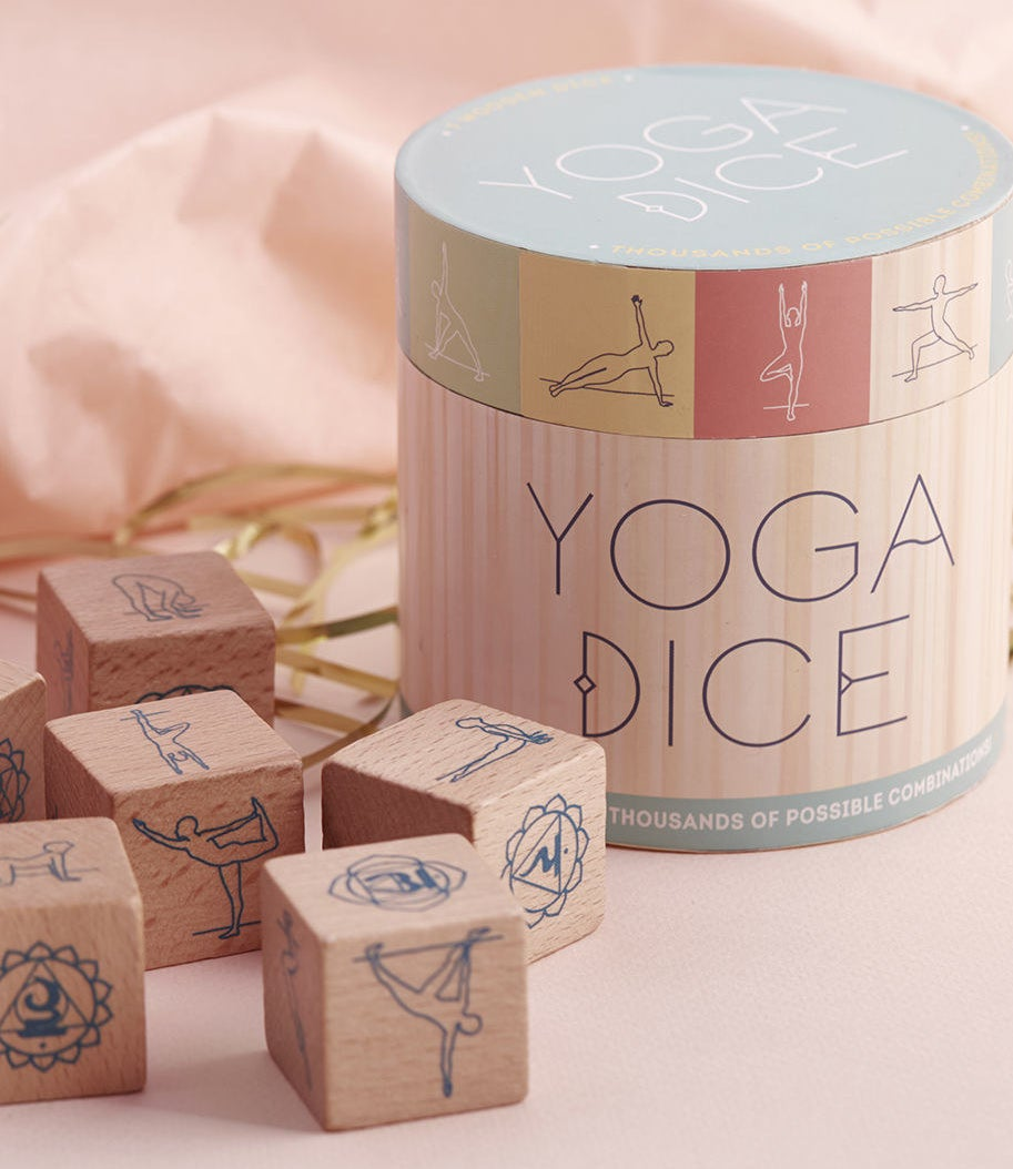 "Each box contains seven wooden dice, which can be rolled to get a unique combo of poses.Promising review: ""This made an excellent gift to my son's girlfriend. She has recently gotten into yoga and told me she loves how this helps her create a new yoga workout each day instead of following the same routine day in and day out."" —AmandaGet them from Amazon for $15.38 or ModCloth for $14.99."