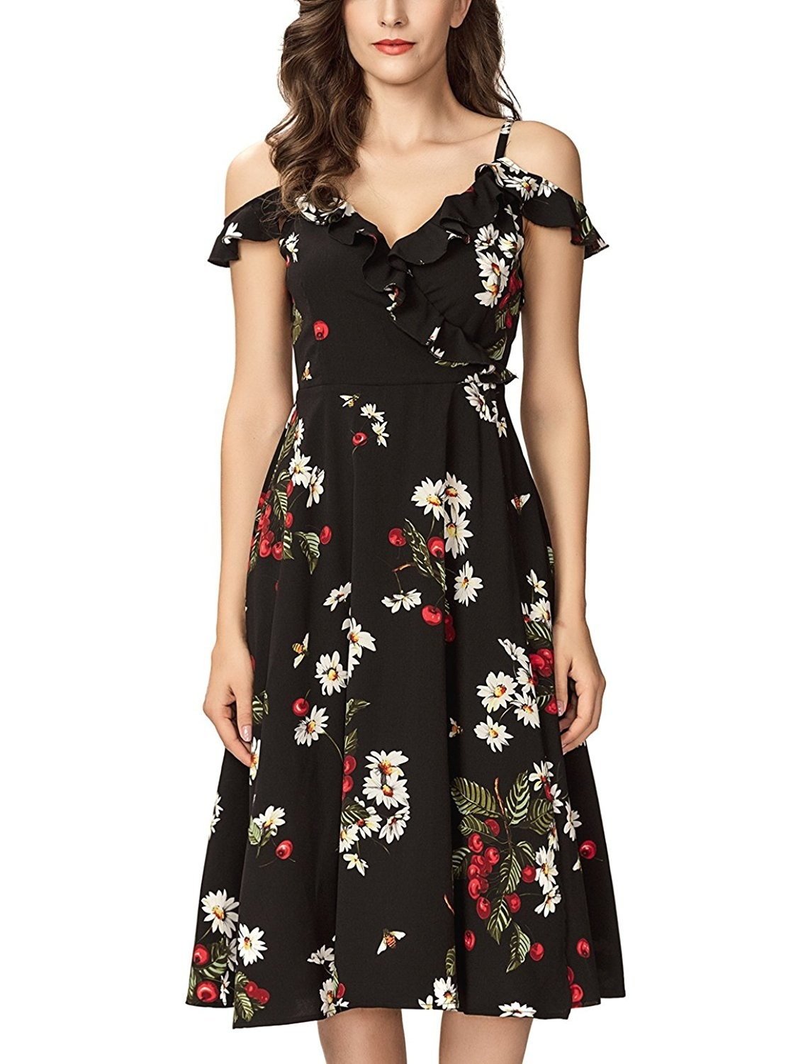 """Promising review: """"This dress is gorgeous! It's very appropriate to wear to a summer evening wedding. It's well-made and fits true to size. It fits me like a dream. Mine is the black one, and I'm debating on getting the white one, as well. That's how much I like it."""" —Cool nerdGet it from Amazon for $34.95 (available in sizes XS-XXL and in three colors)."""