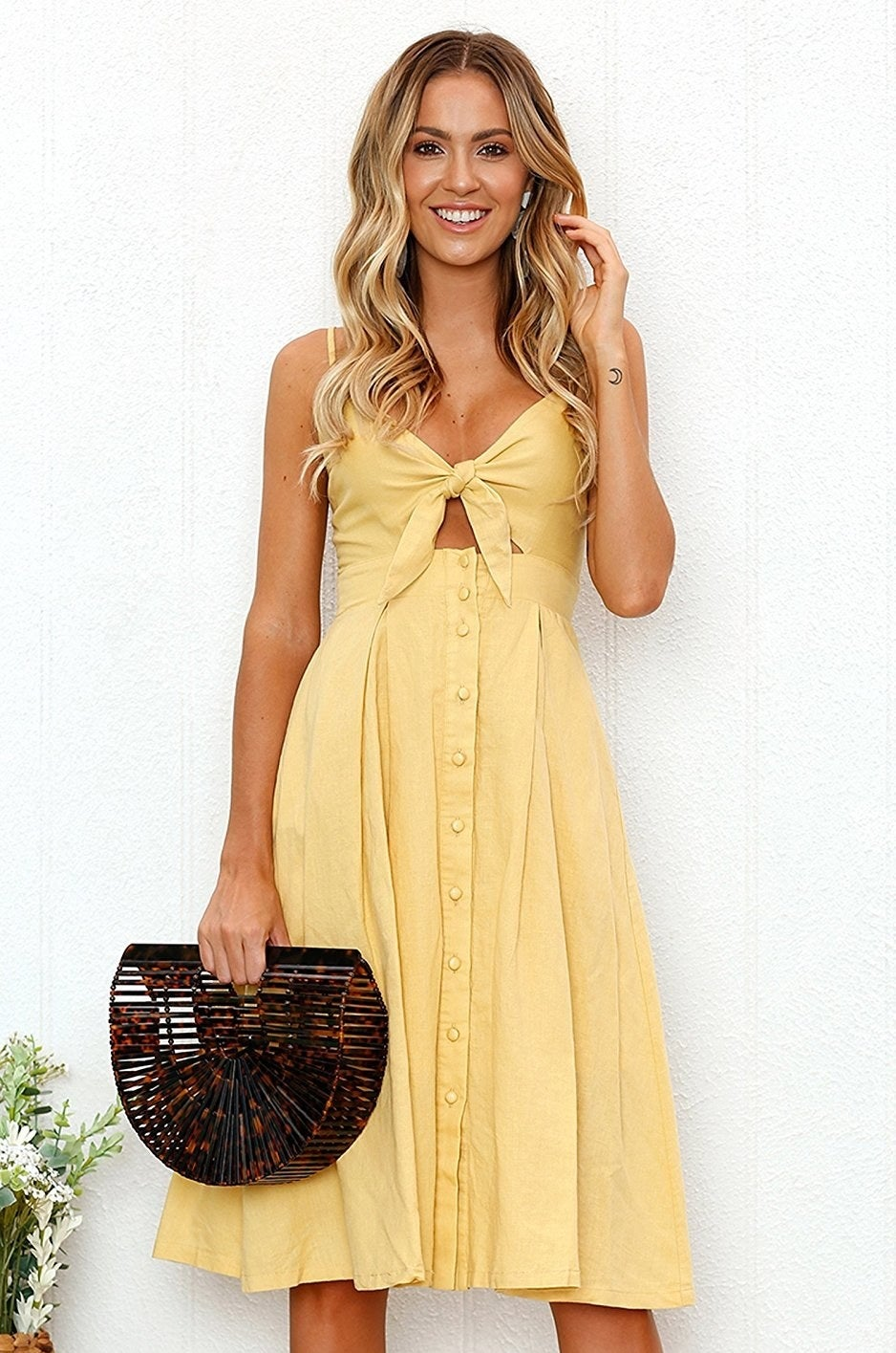 """Promising review: """"I really love this dress. It's super cute for a nice summer day, stroll in the city, or a bridal shower–type dress. It's very fun and flirty but classy at the same time. I love the top piece and how you tie it. It's super adorable; I highly recommend it!"""" —Dena HGet it from Amazon for $6.99+ (available in sizes S-XL and in 14 colors)."""
