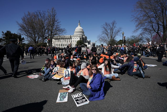 Immigration activists stage a civil disobedience to shut down Independence Avenue March 5 on Capitol Hill.