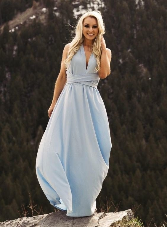 """Promising review: """"The dress is great. I'm using it as bridesmaids dress for a wedding. Each of us can tie the top a different way so that we will all have our own style but still match. I like the empire waist and that you can customize the top. It's flattering on all people as long as you tie it to the style that best suits you. I highly recommend."""" —Aubs RobsGet it from Amazon for $18.79+ (available in sizes S-XL and in 20 colors)."""