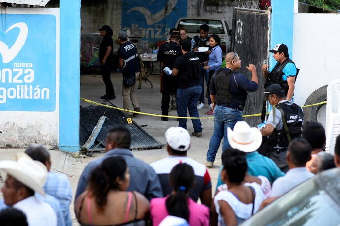Police officers guard a crime scene where mayoral candidate Santana Cruz Bahena was gunned down at his home in the municipality of Hidalgotitlán, in the state of Veracruz, Mexico, Nov. 20, 2017.