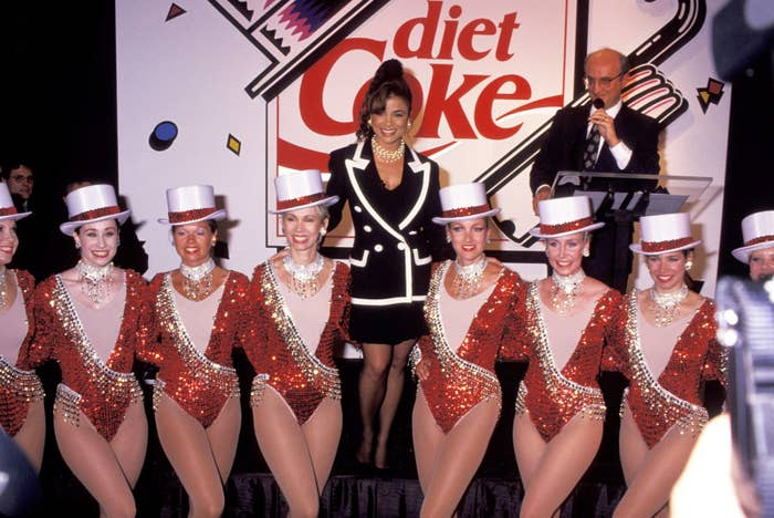 Paula Abdul and the Rockettes during the unveiling of a Diet Coke sign at Times Square in New York City, July 1992.