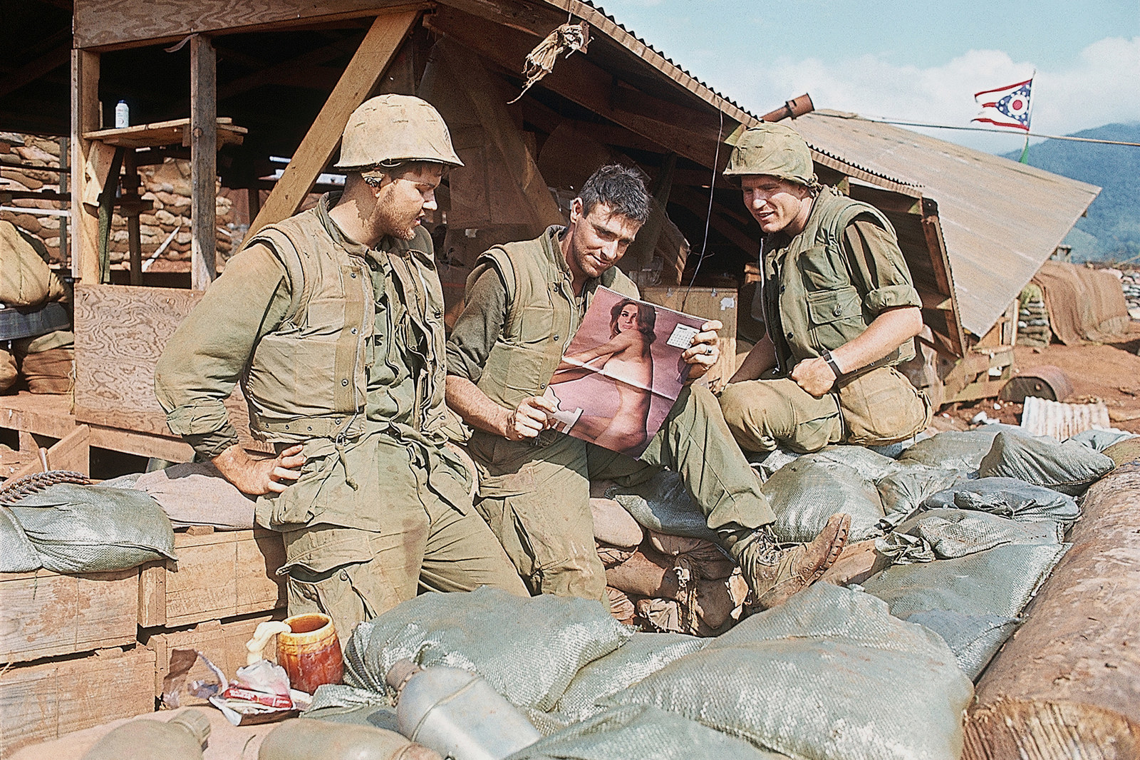 A group of Marines ogle a pinup outside their bunkers at Khe Sanh, South Vietnam, on Jan. 2, 1969.