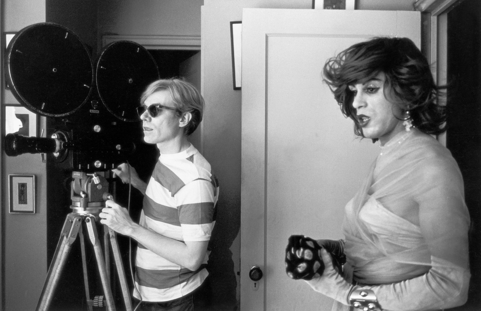 Pop artist Andy Warhol and actor Mario Montez on the set of his film Chelsea Girls, in New York City, 1967.