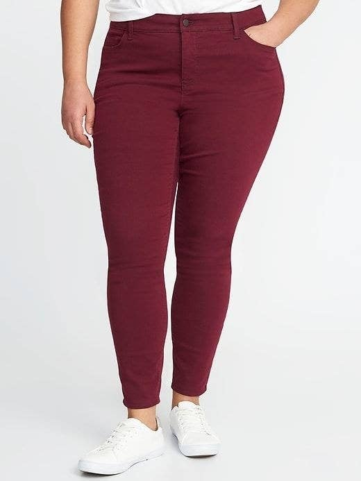 3e6ac3df9f622 Explore colored jeans without leaving your comfort zone. Warm hues like  maroon have the same visual effects as a dark wash