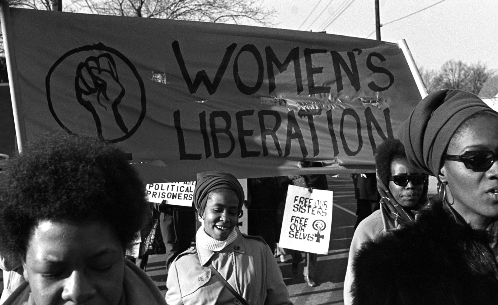 """A group of women march under a """"women's liberation"""" banner and in support of the Black Panther Party in New Haven, Connecticut, in 1969."""