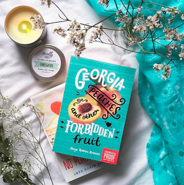 """""""Georgia Peaches and Other Forbidden Fruit by Jaye Robin Brown is about an out daughter of an accepting pastor who moves to a smaller town and decides to re-closet herself, but then winds up falling for one of her friends.""""—ivannai4d6012717Get it from Amazon for $12.59, Barnes & Noble for $8.63, or a local bookseller through IndieBound."""