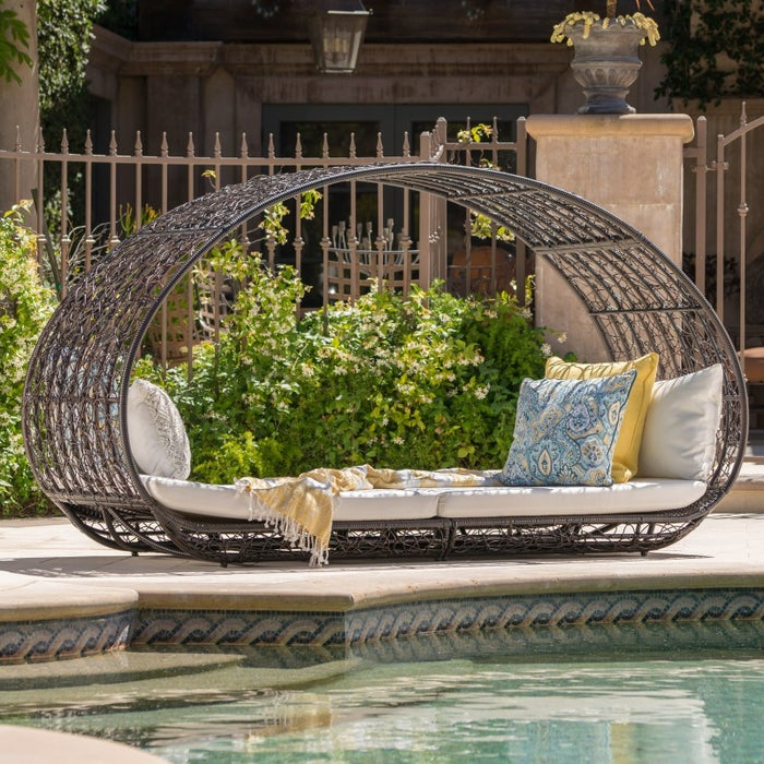 Why it's great: If you need to outfit an outdoor room STAT, this is a solid place to go. There are tons of coordinating sets within a range of price points, which is wonderful whether you have a postage stamp of patio or a sprawling estate. But seriously though, get off my lawn if you think relaxing in a wicker basket hanging chair in front of a waterfall sounds like a subpar idea. Categories: dining sets, bistro sets, dining tables, dining chairs, hammocks and swings, chaise lounges, club chairs, daybeds, ottomans, sofas and loveseats, accent tables, coffee tables, side tables, bar stools, benches, rocking chairs, and Adirondack chairsShipping: Standard free shipping on $45+ orders and $4.95 shipping for orders less than $45 to the contiguous 48 U.S. Free shipping to Canada on overs $59+ CAD. Some items on this chart may take longer to ship. More shipping info.Get this daybed with cushions for $832.99.