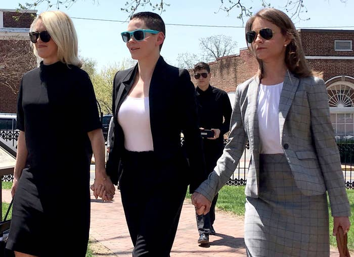 Rose McGowan, flanked by her lawyers outside the Loudoun County courthouse in Virginia where she's facing a drug possession charge, May 2018.