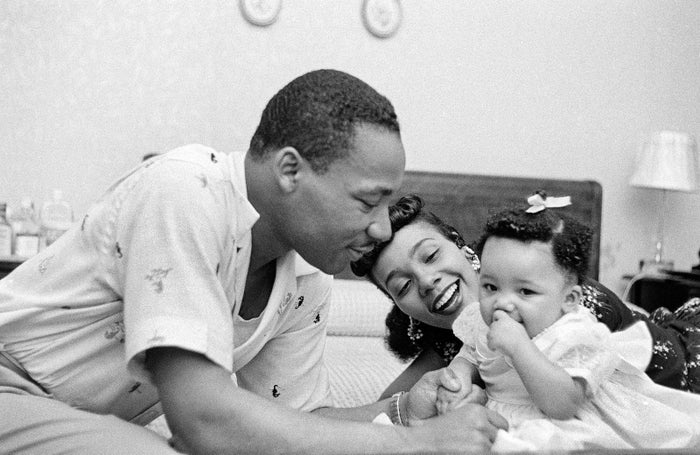Martin Luther King Jr. relaxes at home with his wife, Coretta, and first child, Yolanda, in May 1956 in Montgomery, Alabama.
