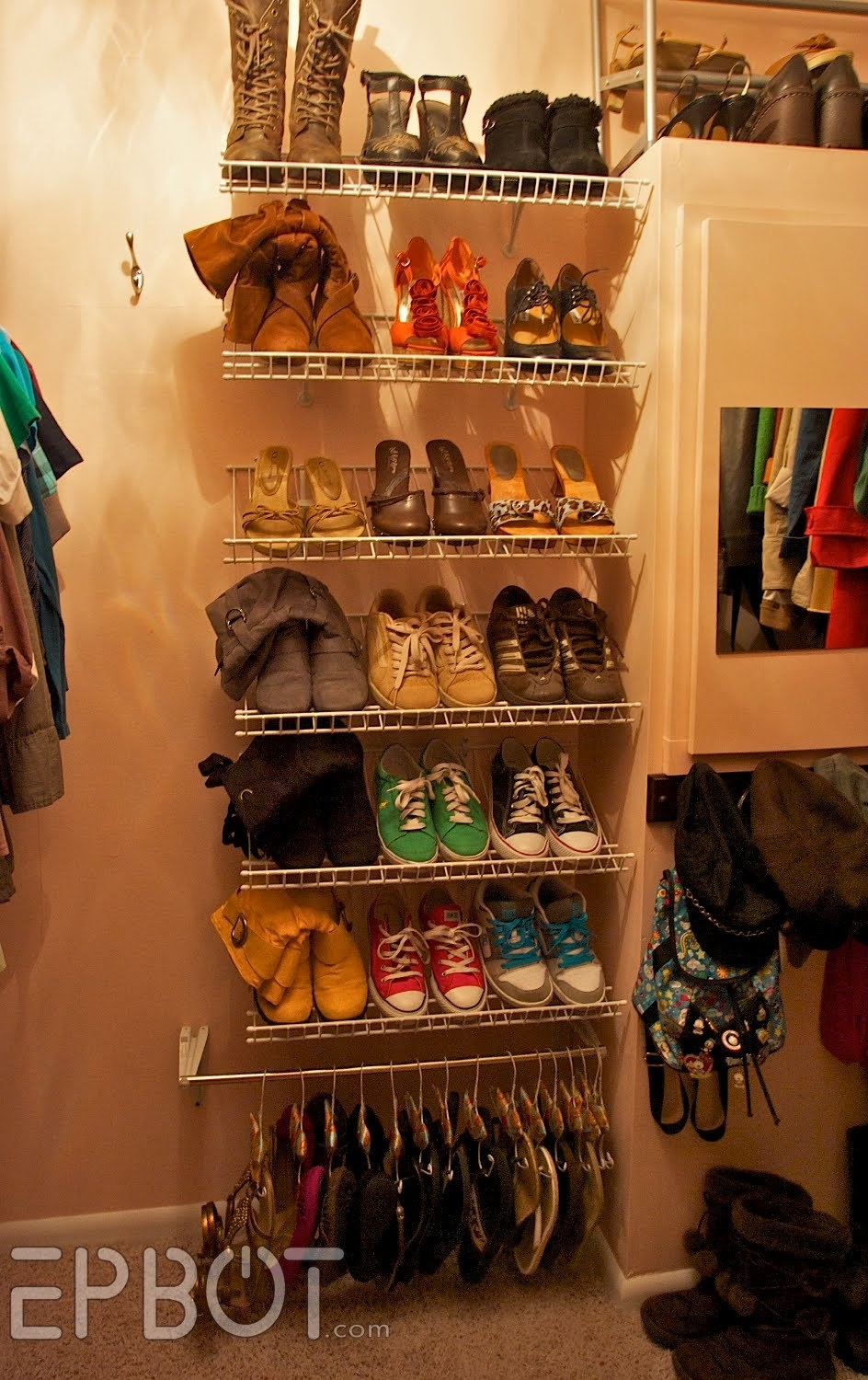 A blogger's closet; five upside-down wire shelves, hung at an angle, fit and display three pairs of shoes each