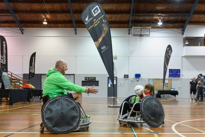 A father and his daughter play wheelchair rugby during the ACC Paralympics New Zealand Open Day on Feb. 18, in Christchurch, New Zealand.