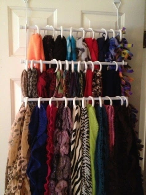 Blogger's scarves on three-tier over door rack, each looped in a shower curtain ring
