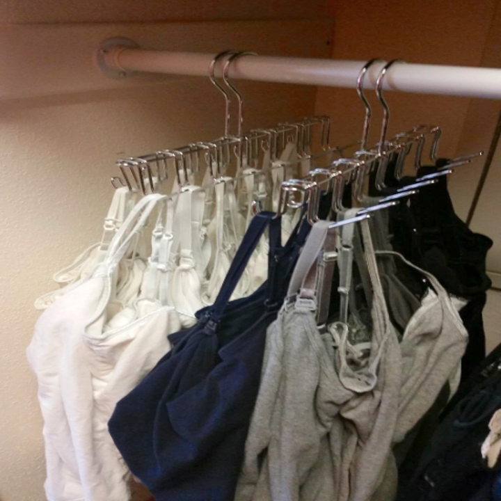 A customer review photo of them using the hanger to hang their tank tops