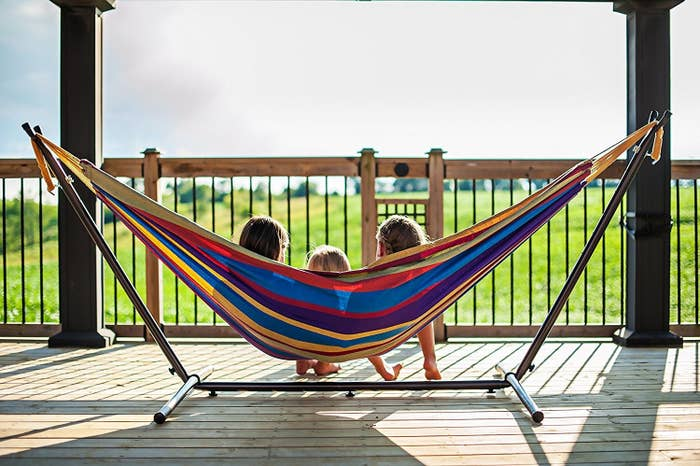 """Promising review: """"Love it. It is very comfortable and durable. I have a family of four. My husband myself and two children were able to relax in this at the same time. Oh and it is very sturdy. When I first bought it whenever it rained I use to take the hammock inside of the house. One day I forgot and it poured down rain outside that night. In the morning the hammock was dry as can be. It is truly water-resistant. So don't bother to bring it inside on those rainy days. Love it!"""" —Jennifer AbrahamPrice: $89.99 (available in 19 colors)"""