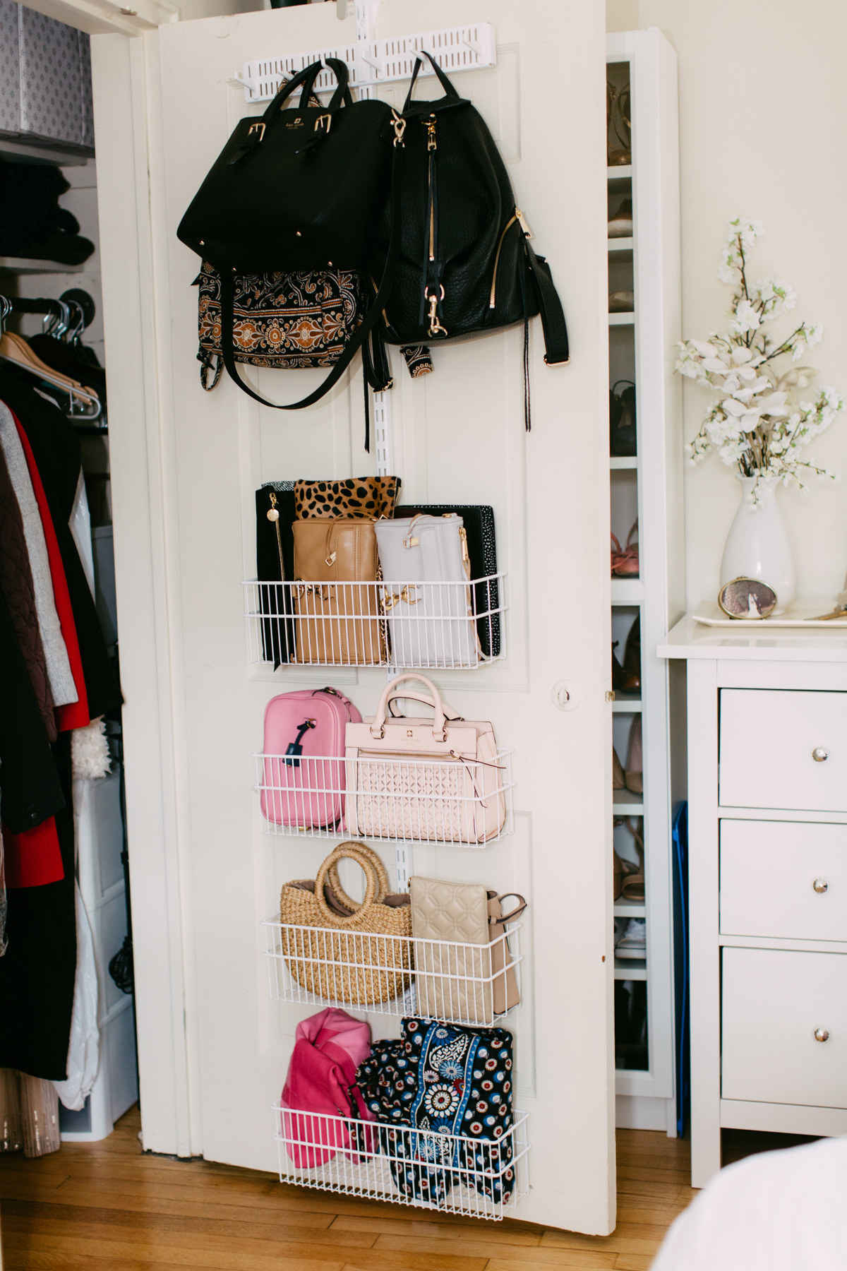 Blogger's closet door with hook rack at the top for three bags, then four wire shelves filled with clutches and other purses and bags