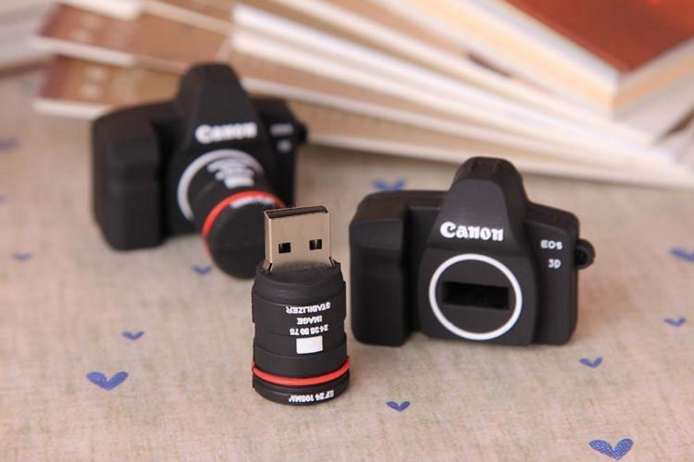 a tiny camera with the lens removed to the show the usb drive inside