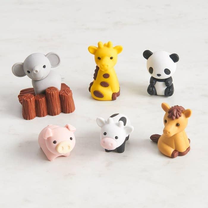 erasers that look like an elephant, giraffe, panda, pig, cow, horse, and stump
