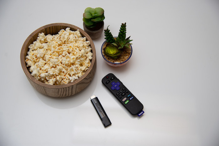 roku remote next to popcorn