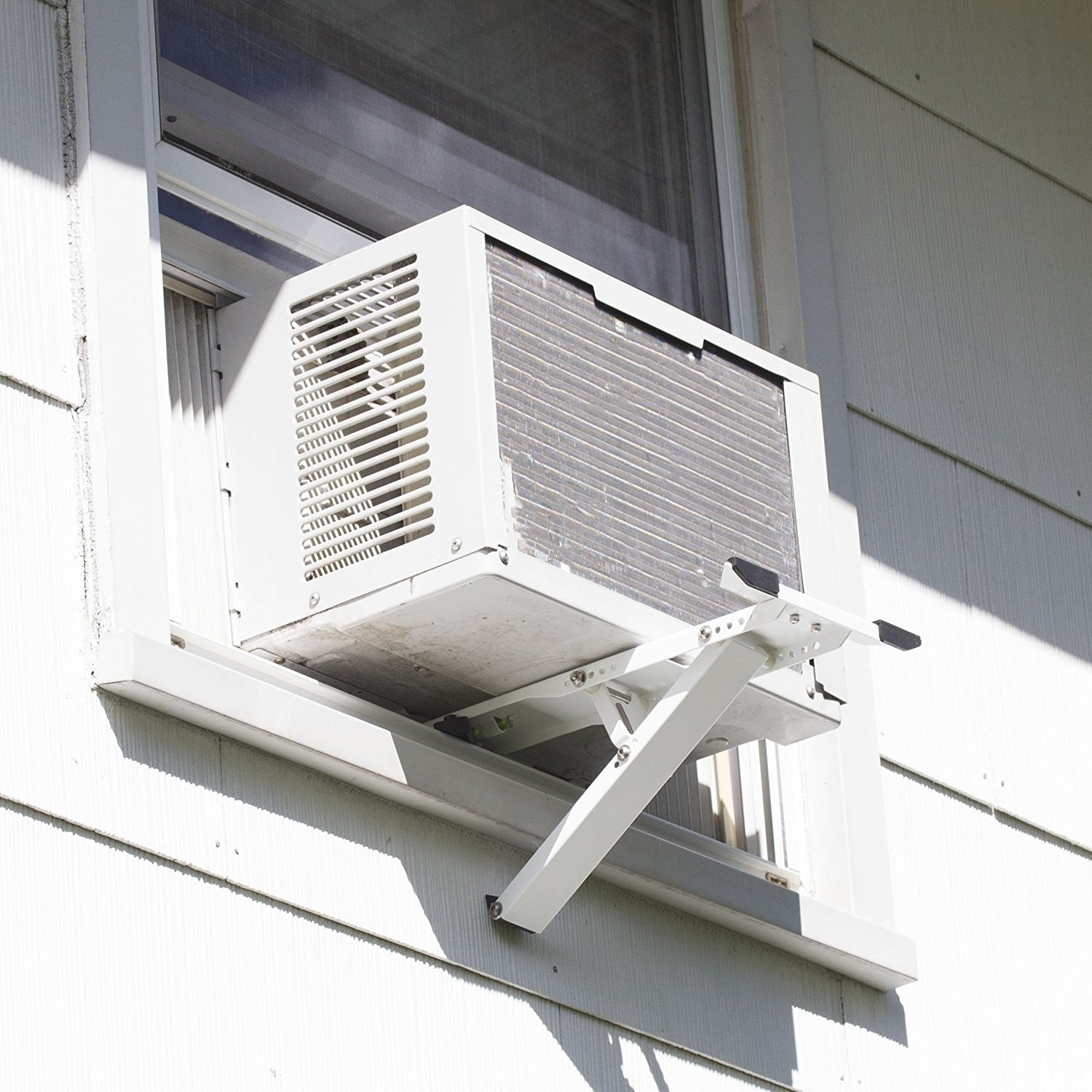 A window AC unit installed with a bracket