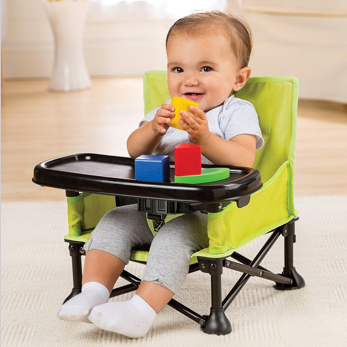 """Promising review: """"These chairs are so awesome! They will make it so easy to travel with twins without having a bunch of baby items. Perfect to take to the beach, visit family, and other outings. It allows them to be fed or just contained to play with toys on the tray. Quality material and sturdy metal. The fabric is also strong canvas. The strap-on bags make it easy to sling onto a stroller or shoulder. The tray is strong and is easy to get on and off. The straps are included for use as a booster chair. It fit my five-month-old who is only 13 lbs. pretty good. At least the chairs will last a while without being outgrown. Highly recommend and would buy again. Great shower gift too!"""" —Messy Marvin Price: $29.99 (available in three colors)"""