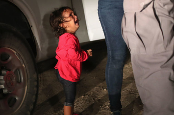 People Are Horrified By This Photo Of A 2-Year-Old Asylum-Seeker Being Stopped At The Border