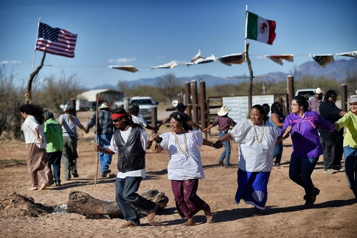 Members of the Tohono O'odham protest against Trump's proposed border wall in March 2017.