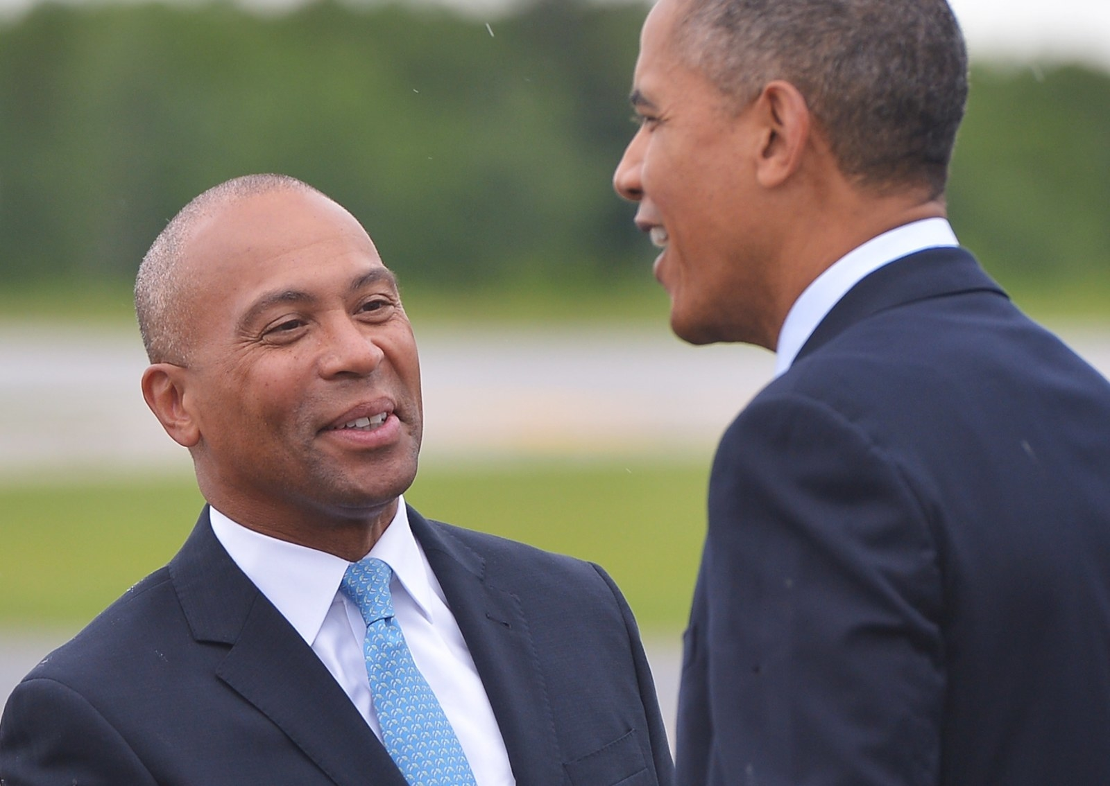 Patrick greets Obama, on a visit to Massachusetts visit in 2014.