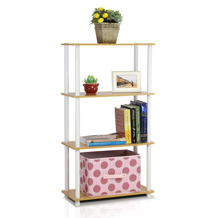 """Promising review: """"I love the size of it! It's not too big but not too small! It doesn't take up a lot of space so it's perfect for small rooms like in apartments or townhouses. It fits a lot of stuff on it and it's sturdy for the price! The shelves are sturdy enough that I was able to stack a bunch of books on it as well as two laptops on another shelf. It was not difficult to assemble and I love the color!"""" —Nick&Laura Price: $22.99+ available in six colors)"""