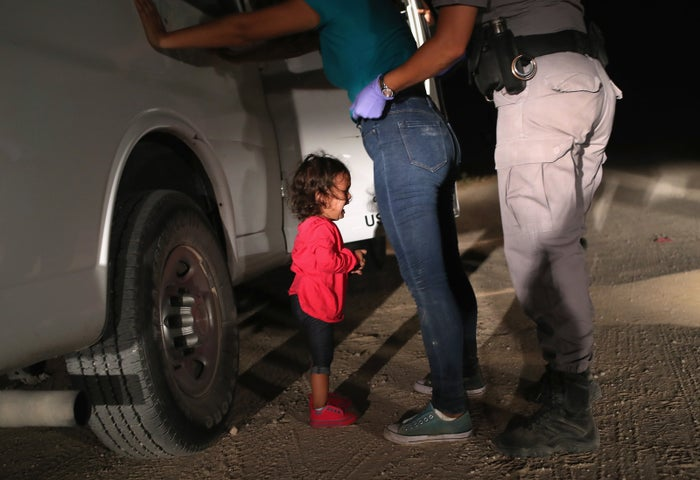 A 2-year-old Honduran asylum-seeker cries as her mother is searched and detained on June 12 in McAllen, Texas.