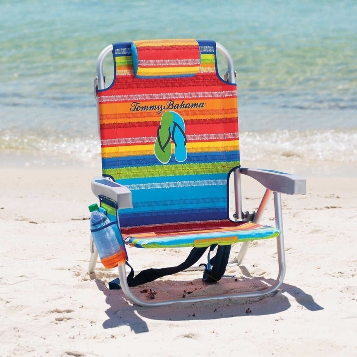 """Promising review: """"These chairs are lightweight, attractive, comfortable, and easy to open/close. I bought them for a trip to the beach and my friend loved it so much she said that she is buying a pair for herself. I love all the features: cup holder, phone/accessory pocket, head rest, and towel bar all work great and really set this chair apart from the rest. I'm torn on what is the best feature, though. You can recline the chairs which is amazing and since it has pockets and a cooler you can haul almost all of your beach gear on your back since it works like a backpack! They are super easy to clean and I can't believe how easy it is to get the sand off the material. I can't say enough good things about these chairs!"""" —KelhePrice: $43.99 (available in 10 colors)"""