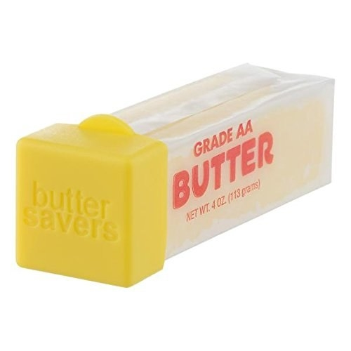 The yellow square butter saver on a stick of butter