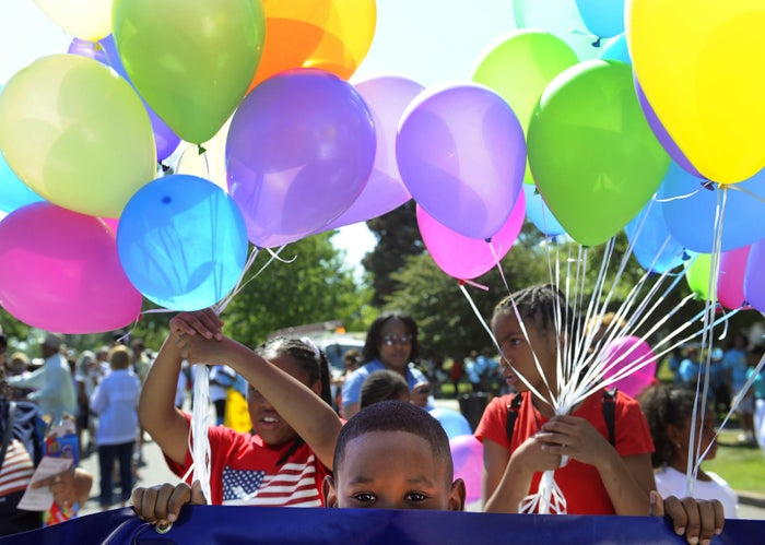 Brian Harris, 8, waits for the parade to begin during the 2011 Denver Juneteenth celebration.