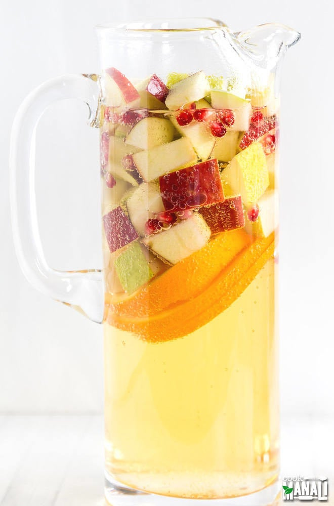 This sangria's got sugar, spice, and everything nice: apples, oranges, pears, pomegranates, and apple cider. Get the recipe here.