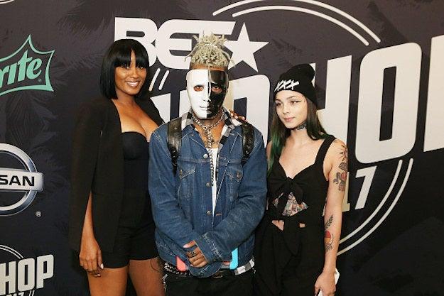 XXXTentacion (center) attends the BET Hip Hop Awards in 2017.