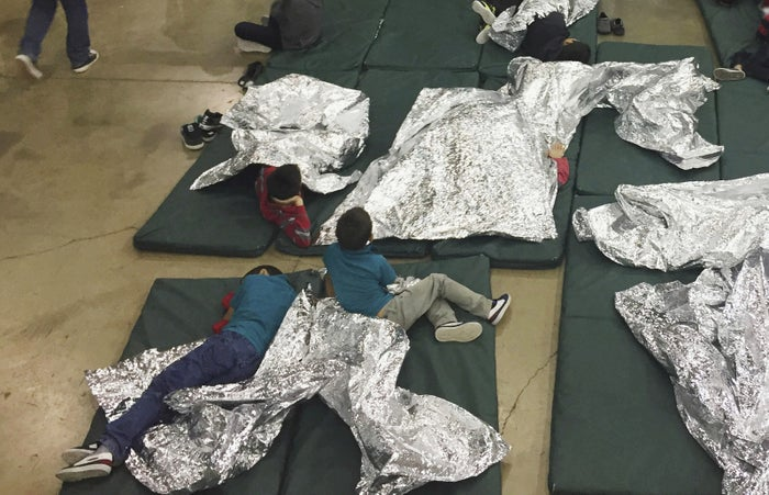 Kids who've been taken into custody related to cases of illegal entry into the United States rest in one of the cages at a facility in McAllen, Texas.