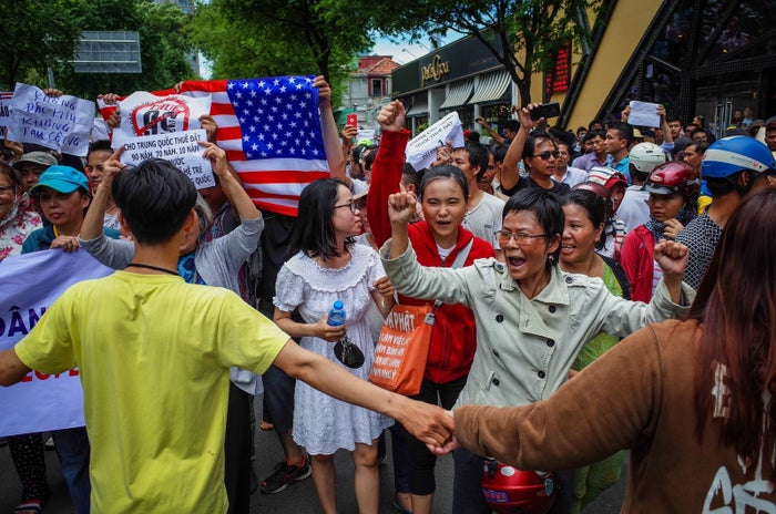 Vietnamese protesters shout slogans against a proposal to grant companies lengthy land leases during a demonstration in Ho Chi Minh City on June 10.