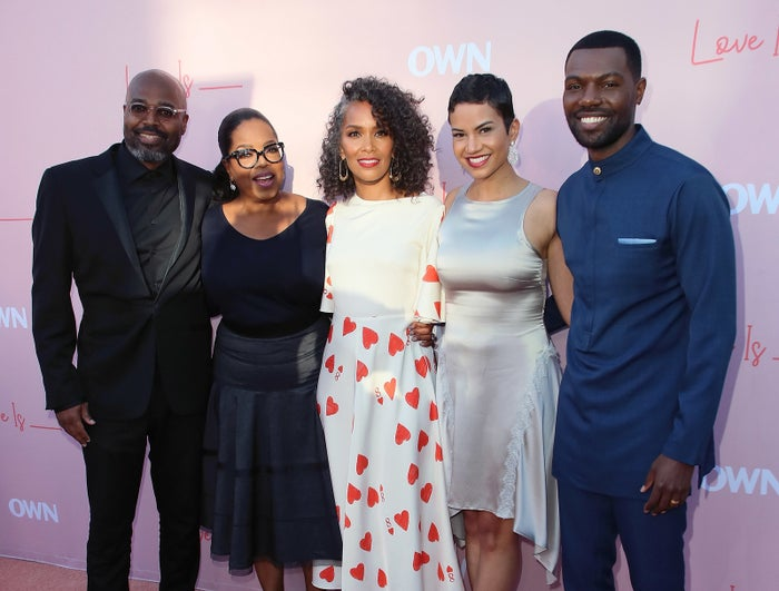 Salim Akil, Oprah Winfrey, Mara Brock Akil, and actors Michele Weaver and William Catlett attend the premiere of OWN's Love Is ___ in Los Angeles.