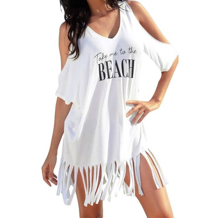 81dae39e7b A fringe cold-shoulder with a statement on it that'll tell everyone just  where you wanna go so you can show off your new coverup.