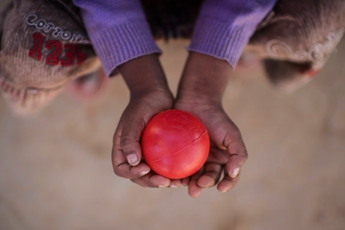 Rohingya migrant Hubaib, 3, whose mother was killed in Myanmar before he fled to Bangladesh with his family, holds a red ball at the Balukhali refugee camp in Cox's Bazar on Nov. 30, 2017.