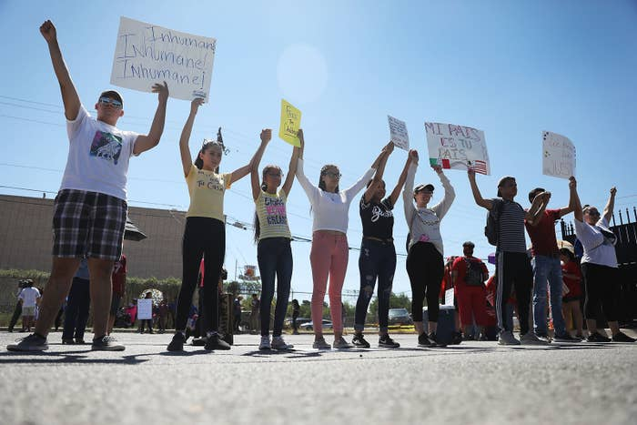 People protest the separation of children from their parents in front of the El Paso Processing Center in Texas.