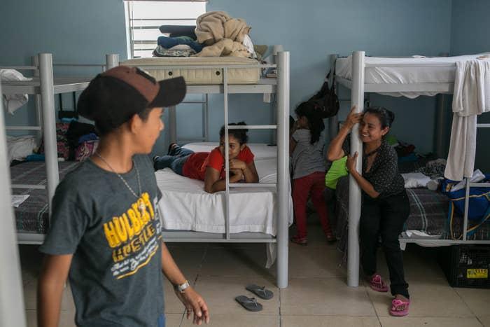 Patricia (center) and Maria (right) watch children play at the Senda De Vida shelter in Reynosa.